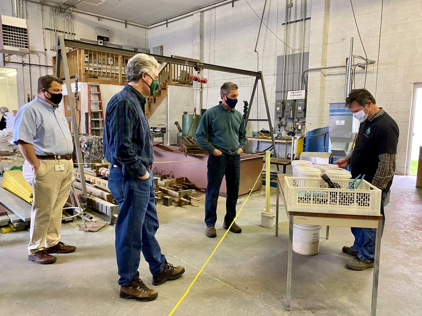Gov. John Carney, center, joined Department of Natural Resources and Environmental Control Secretary Shawn Garvin, second from left, on Thursday to tour Eco Plastic Products of Delaware in Wilmington, where Delaware State Parks will have 15 benches made from excess plastic bags.