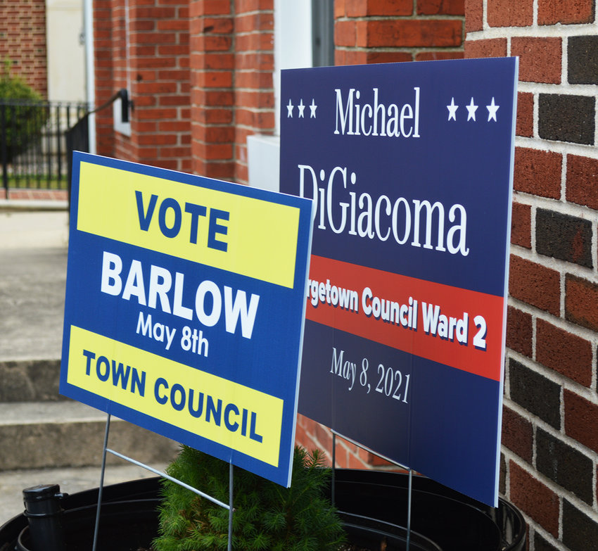 Candidate campaign signs on The Circle Saturday during the Town of Georgetown's 2021 municipal election.