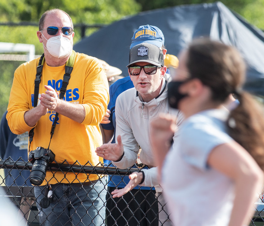 Parents cheer on runners during the Girls 100-meter dash at the Henlopen Conference Championship at Lake Forest High School in Felton on Thursday.