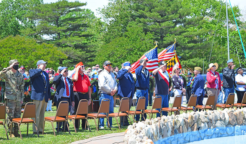 Representatives of veterans' organizations saluted the flag during Memorial Day ceremonies on Long Wharf in Cambridge on May 31.