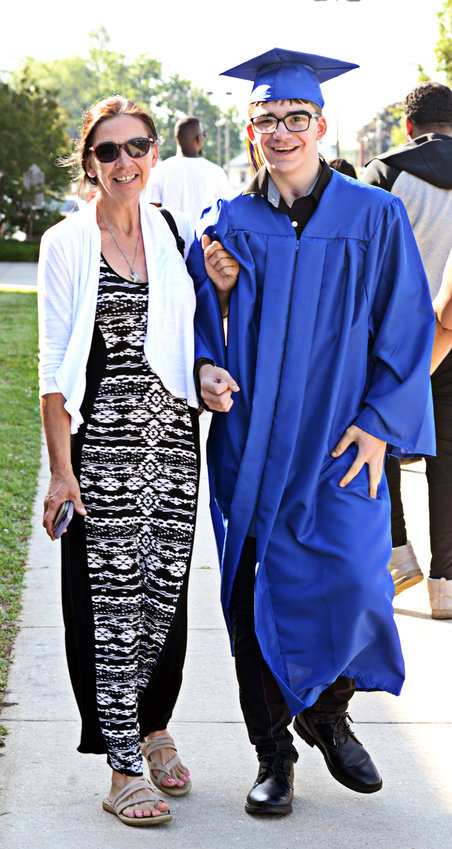Tristan Evans arrives at Caesar Rodney High's commencement exercises Saturday assisted by his mother, Francis Evans, who said he's lucky to be alive. Tristan survived an automobile accident on Dec. 26, 2020.