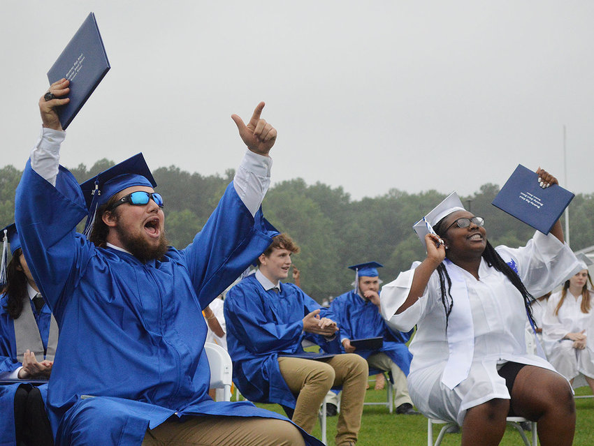Woodbridge High School Class of 2021 graduates Josh Benedict and Jaliyah Cephas celebrate during the June 11 outdoor commencement ceremony.