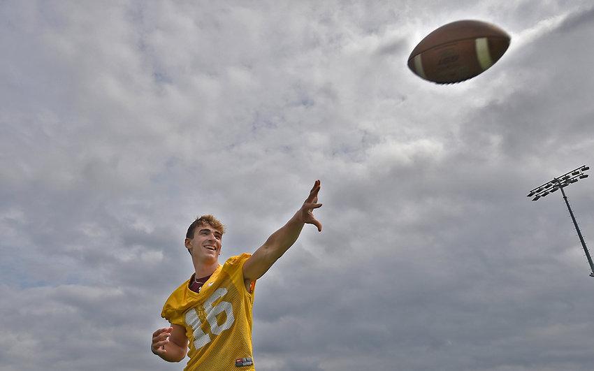 Gold team quarterback Aidan Sanchez from Smyrna High School practices on Sunday at Caesar Rodney High School in Camden.