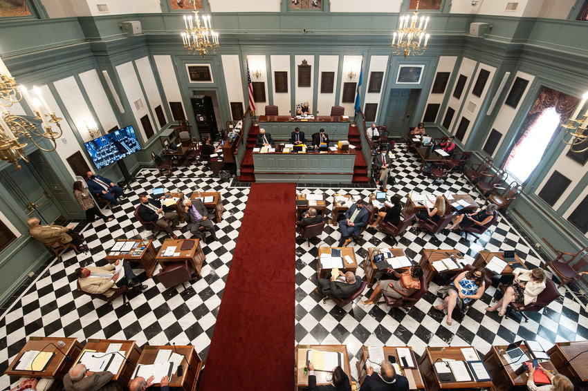 The Delaware State Senate gather in the Senate Chambers at Legislative Hall in Dover on Thursday..