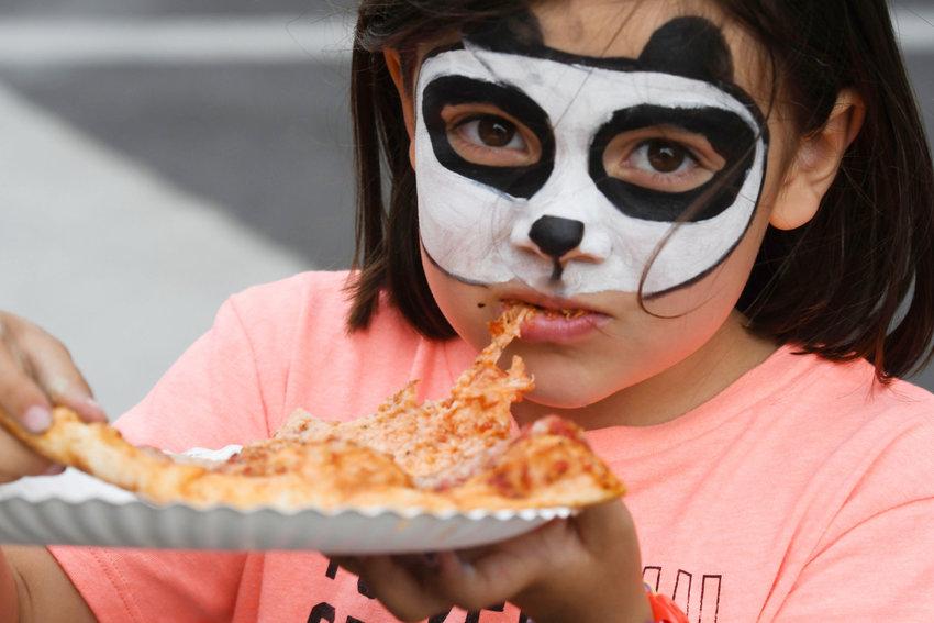 Cameron Barnes, 5, of Salisbury, enjoys a slice of pizza.