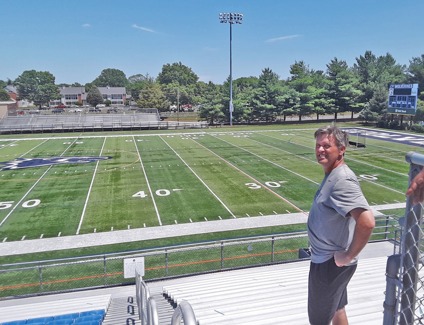 Wesley football coach Chip Knapp takes a look around the stadium on Wednesday afternoon on the final day of the school athletic department's existence.
