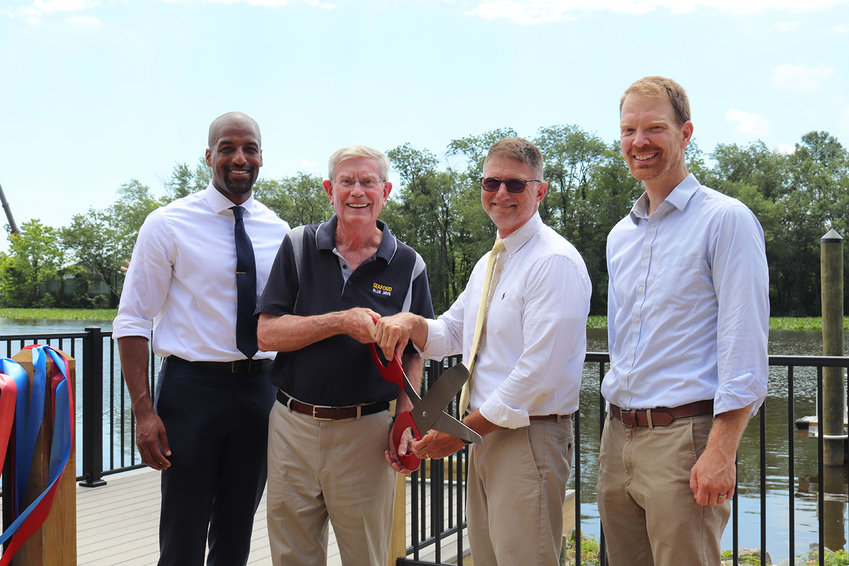 A ribbon-cutting dedicating the first phase of the Oyster House Park along the Nanticoke River in Seaford was held Thursday. From left, are Mark Conway, Chesapeake Conservancy executive vice president; Chesapeake Conservancy Board of Directors Chair Randy Larrimore; Seaford Mayor David Genshaw; and Joel Dunn, Chesapeake Conservancy president/CEO.