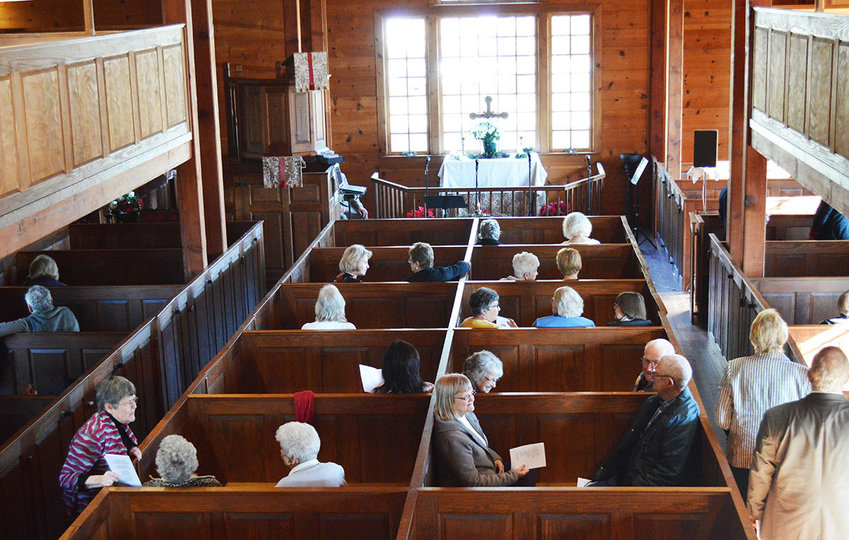 Pews fill up for the 2019 Olde Christmas at Prince George's Chapel in Dagsboro. The historic chapel, closed since March 2020 during the pandemic, reopens this weekend.