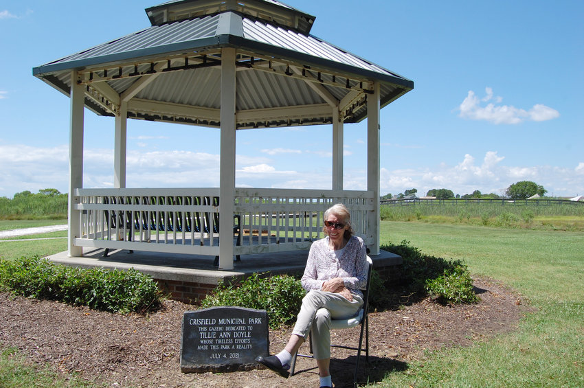 Tillie Doyle by the marker in her honor at Crisfield Municipal Park.