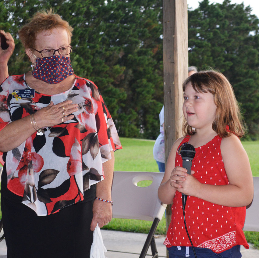 American Legion Auxiliary Unit 28 junior member Makenzie Mood leads the Pledge of Allegiance at the 2020 9/11 remembrance event. At left is June Jones, ALA Unit 28 vice president.