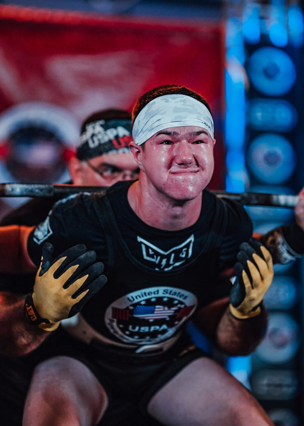 Garrett Rogers, 15, of Millsboro, grimaces during an attempt at the U.S. Powerlifting Association Nationals Championships in Palm Springs, California, earlier this month. Garrett set several records during the event.