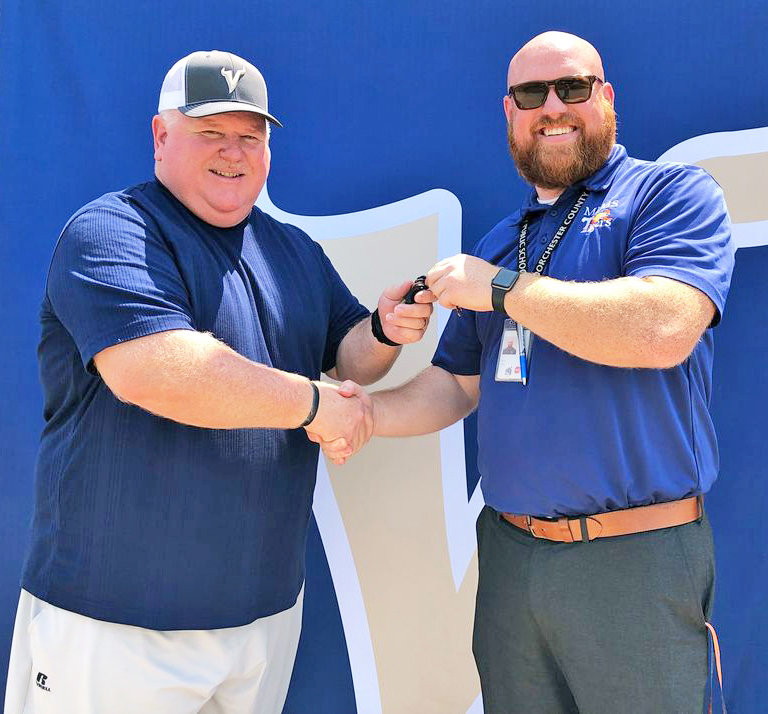Toby Peer, at left, was announced Wednesday as the new Head Coach of the Cambridge-South Dorchester High School football team. Coach Peer comes from South Hagerstown High School, where he served double duty as head football coach and athletic director. Outgoing Head Coach Gaven Parker formally handed over the coaches' keys to Coach Peer, signifying the changing of the guard. Coach Peer brings 27 years of football coaching experience to Fleetwood Field at McWilliams Stadium.