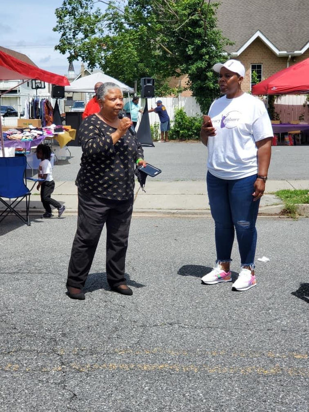The Rev. Rita Paige, left, speaks at a recent Kent County Coalition vaccination event. The coalition, formed in March, seeks equitable distribution of the COVID-19 shots and has administered more than 9,500 of them.