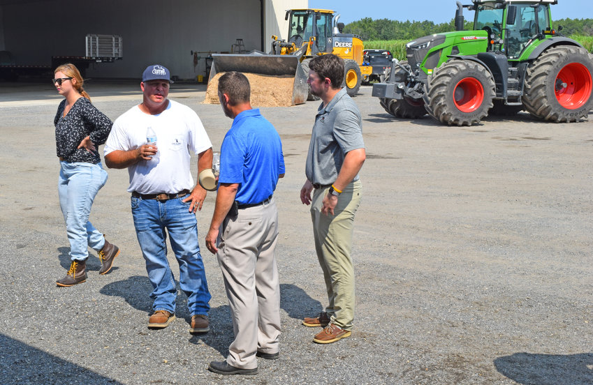 A group of industry representatives and elected officials took part in the Maryland and Dorchester Farm Bureau's Legislative Tour on Aug. 26. Some of the group is seen above at the Luthy Farm south of Cambridge. Owner John Luthy is second from the left.