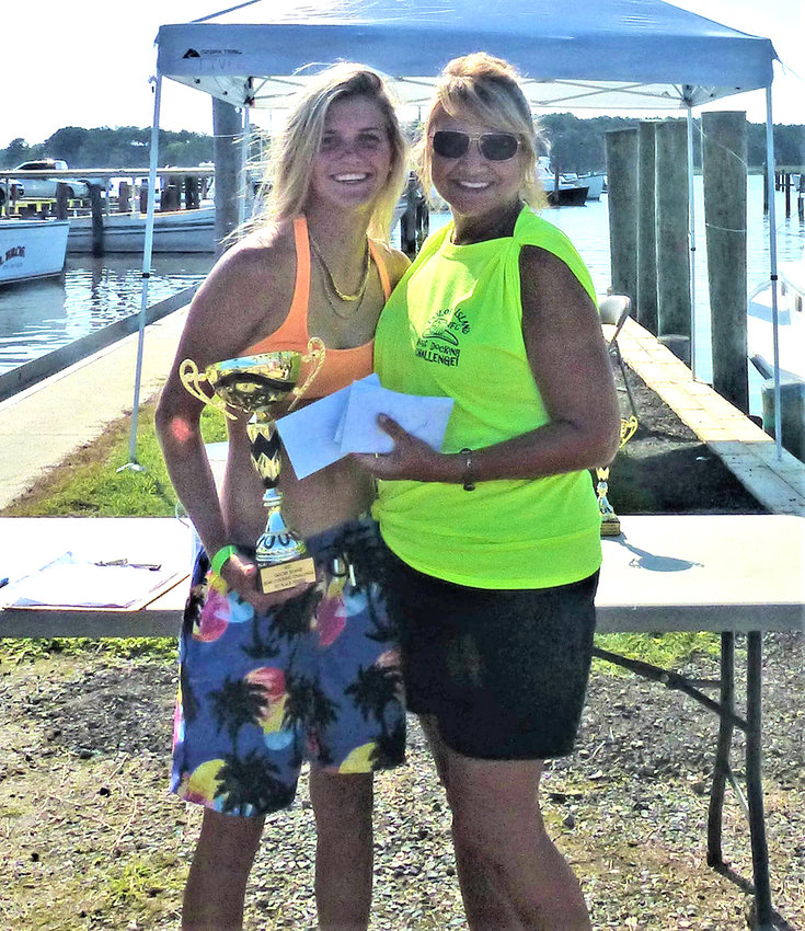 """Taylors Island Volunteer Fire Company President Patti Tieder presents 1st place award (Youth - under the age 18) to Sydney Hughes - Captain of """"Mackenzie Anne""""."""