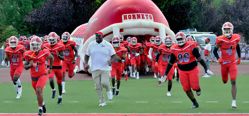 DSU head coach Rod Milstead leads his team out on the field to play Georgetown University Saturday afternoon.