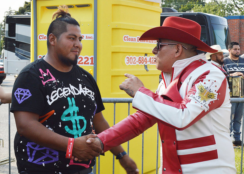 Amer Gomez, left, of Georgetown meets popular singer/musician Aurelio Fernandez of Los Amigos del Jefe following the group's performance Sunday at Maxima Hispanic Fest 2021.