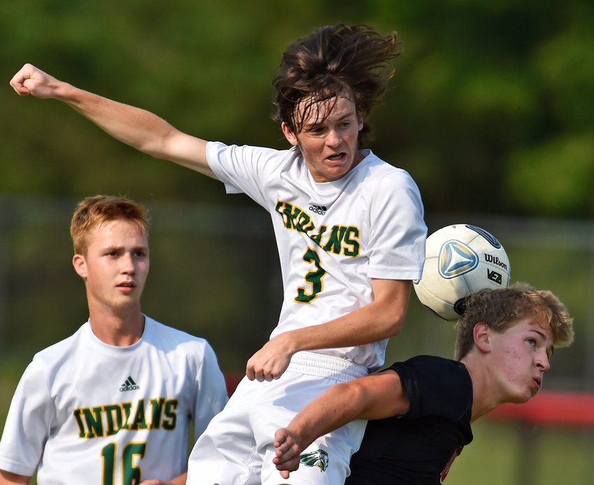 Indian River's Dane Shuart, left, and Polytech's Kade Seip, battle for the ball on Monday in Woodside.