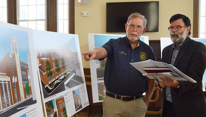 Jim Bowden, president of the Georgetown Historical Society, points out revised architectural renderings for the new Sussex County Family Courthouse as he speaks with Rick Macia of CGL Companies. Updated designs for the courthouse were presented Wednesday.