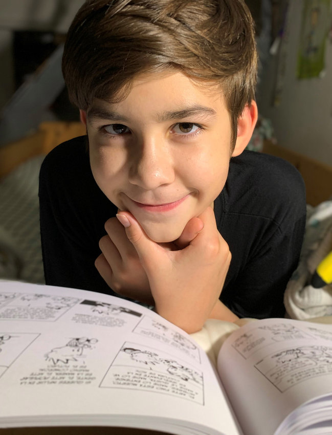 Author Máximo César Castellanos, 12, of Georgetown, is bilingual in Spanish and English.