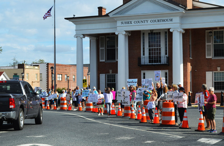 People with signs opposing what they call uncontrolled overdevelopment in Sussex County staged a public protest on The Circle on Tuesday prior to the Sussex County Council meeting.
