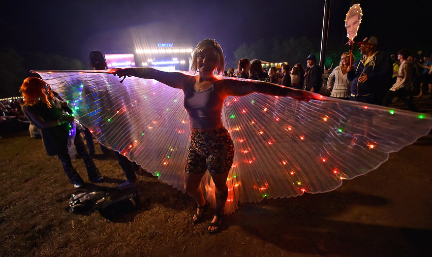 A woman displays her lighted wings on Saturday night during the Firefly Music Festival in Dover.