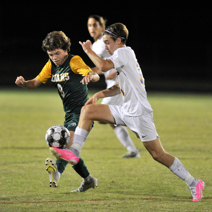 Parker Steele of Indian River and CR's Sean Capezio battle for possession in the first half.