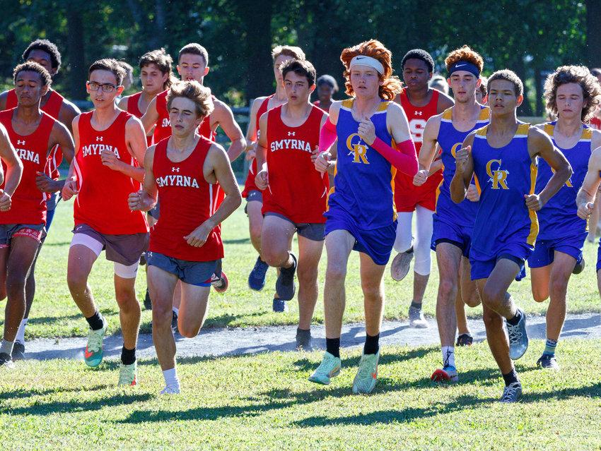 Start of the Smyrna High School vs. Caesar Rodney High School boys' cross country meet at Brecknock Park on Wednesday.