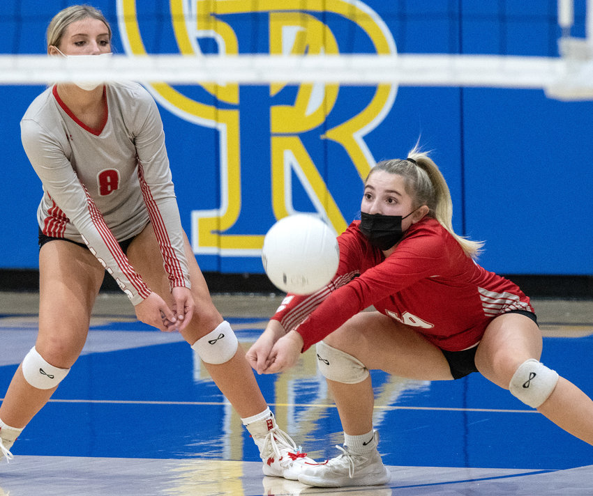 Smyrna's Carly Timblin digs as her teammate Sklar Berge backs her up against Caesar Rodney at CR on Thursday.