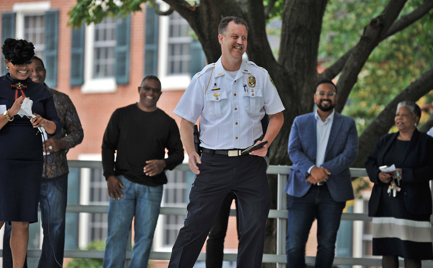 Dover Police Chief Thomas Johnson smiles after speaking on stage during the second annual Faith & Blue event held on Sunday at The Green in Dover.