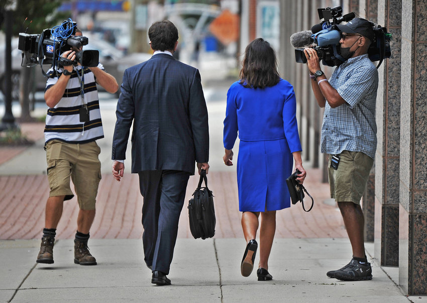 Delaware State Auditor Kathy McGuiness and her attorney Steve Wood walk on King Street after leaving the Leonard L. Williams Justice Center on Tuesday in downtown Wilmington.