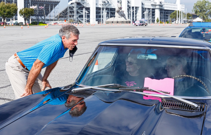 Governor John Carney welcomes Sherry and Tom Keiling to the COVID-19 vaccination clinic at the Dover International Speedway on Saturday morning.