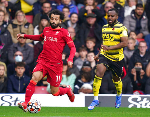 Liverpool's Mohamed Salah, left, and Watford's Danny Rose battle for the ball during the English Premier League soccer match between Watford and Liverpool at Vicarage Road, Watford, England, Saturday, Oct. 16, 2021. (Tess Derry/PA via AP)