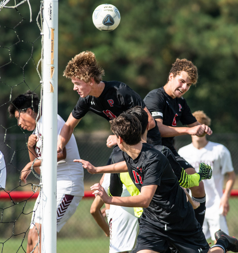 Polytech's Kade Seip, left, and Wyatt Simmons go for a head shot on a head shot in the first half against Hodgson at Poly on Saturday.