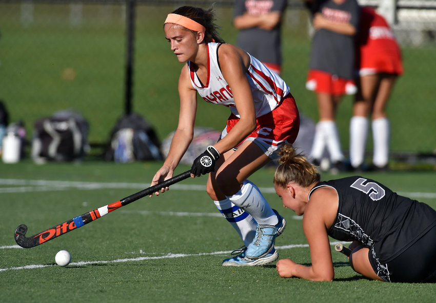 Smyrna's Dru Moffett works the ball past Sussex Tech's Karli Penrod at mid field on Tuesday in Smyrna.