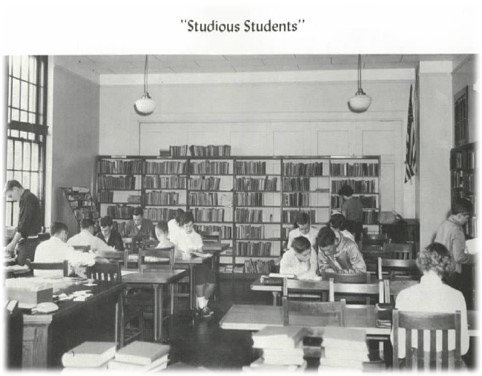 """A group of """"studious students"""" are pictured at work in a photo taken in 1955."""