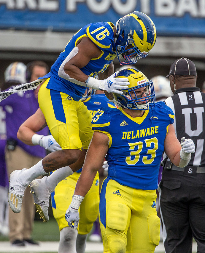 Blue Hen linebacker Johnny Buchanan (is congratulated by teammate Nijuel Hill after making a tackle on Saturday.