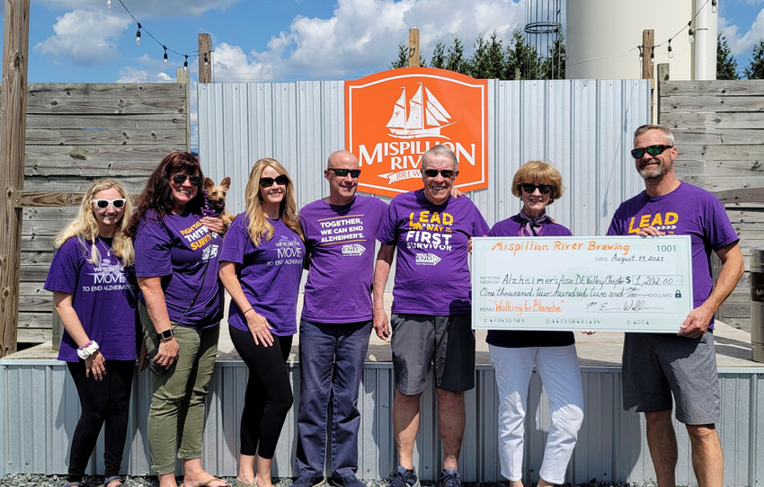 From left, Lilly Barnett, Kelly Barnett with Diaz, Kathleen Archino, Michael McDonough, Don McDonough, Stephanie McDonough and Eric Williams, president of Mispillion River Brewing at the Walking for Blanche fundraiser.