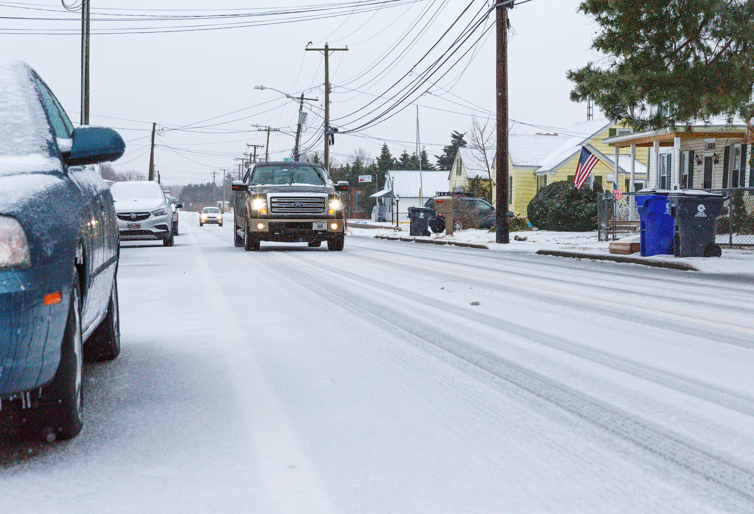 Cars move slowly on Main Street in Little Creek because of icy road conditions on Thursday morning.