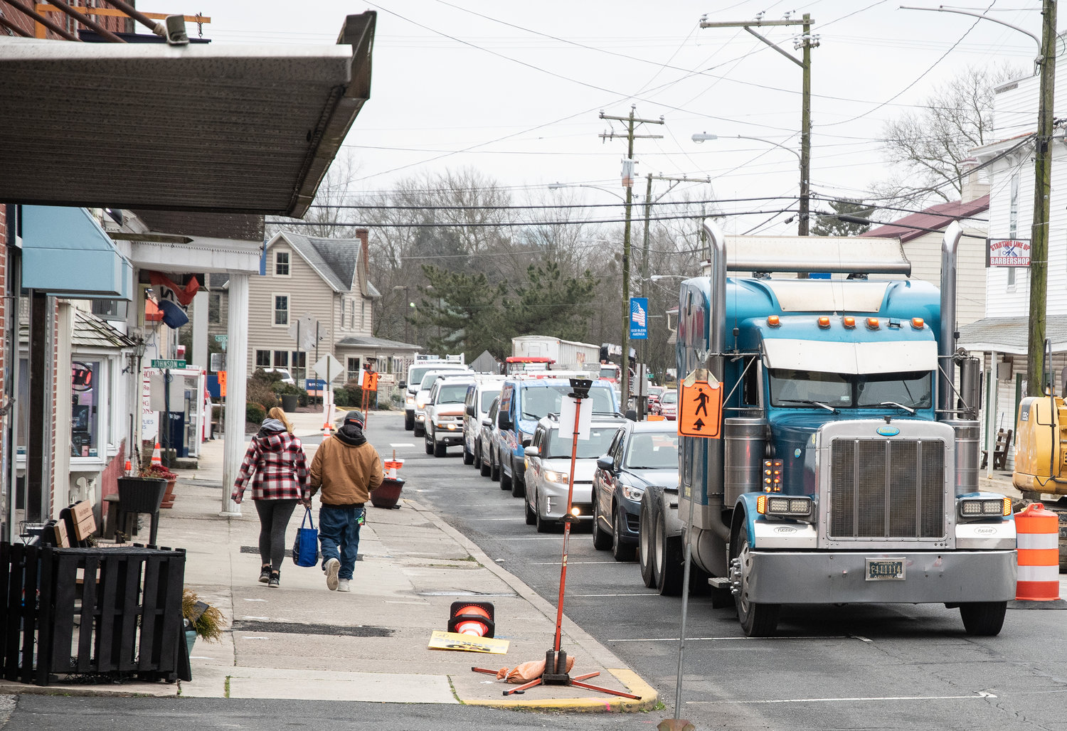 Traffic is backed up on Main Street during downtown road construction in Millsboro. Some businesses along the route report they are struggling, due to lack of parking.