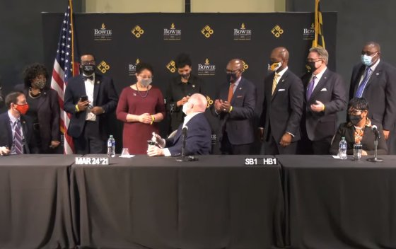 Gov. Larry Hogan signs a law March 24 to resolve a 15-year federal lawsuit that challenged the fundamental history of how the state supports its public institutions of higher education