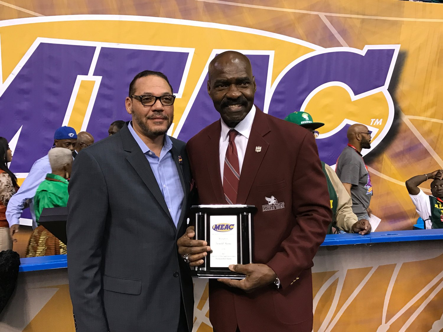 Athletic Director Keith Davidson presents Gerald Irons with