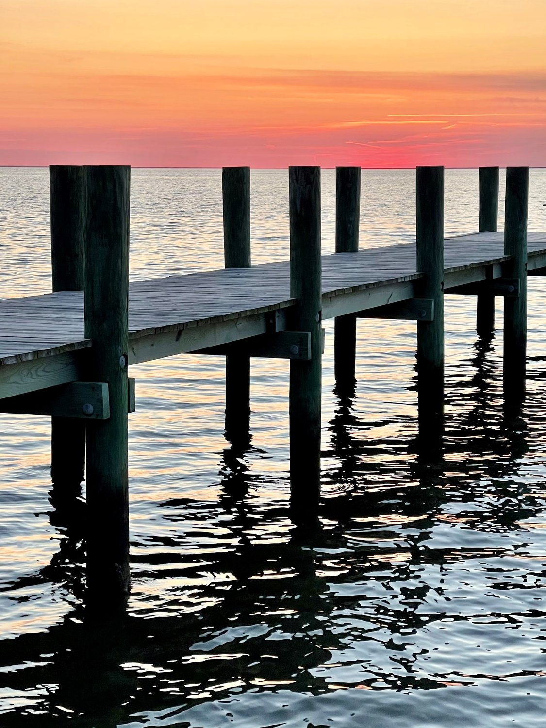 Deal Island photographer Carrie Samis recently recorded this dock holding the sky aloft over Tangier Sound.