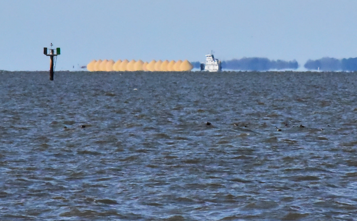 Photographer Tracy Sahler captured a barge loaded with fill soil on the horizon of Tangier Sound.