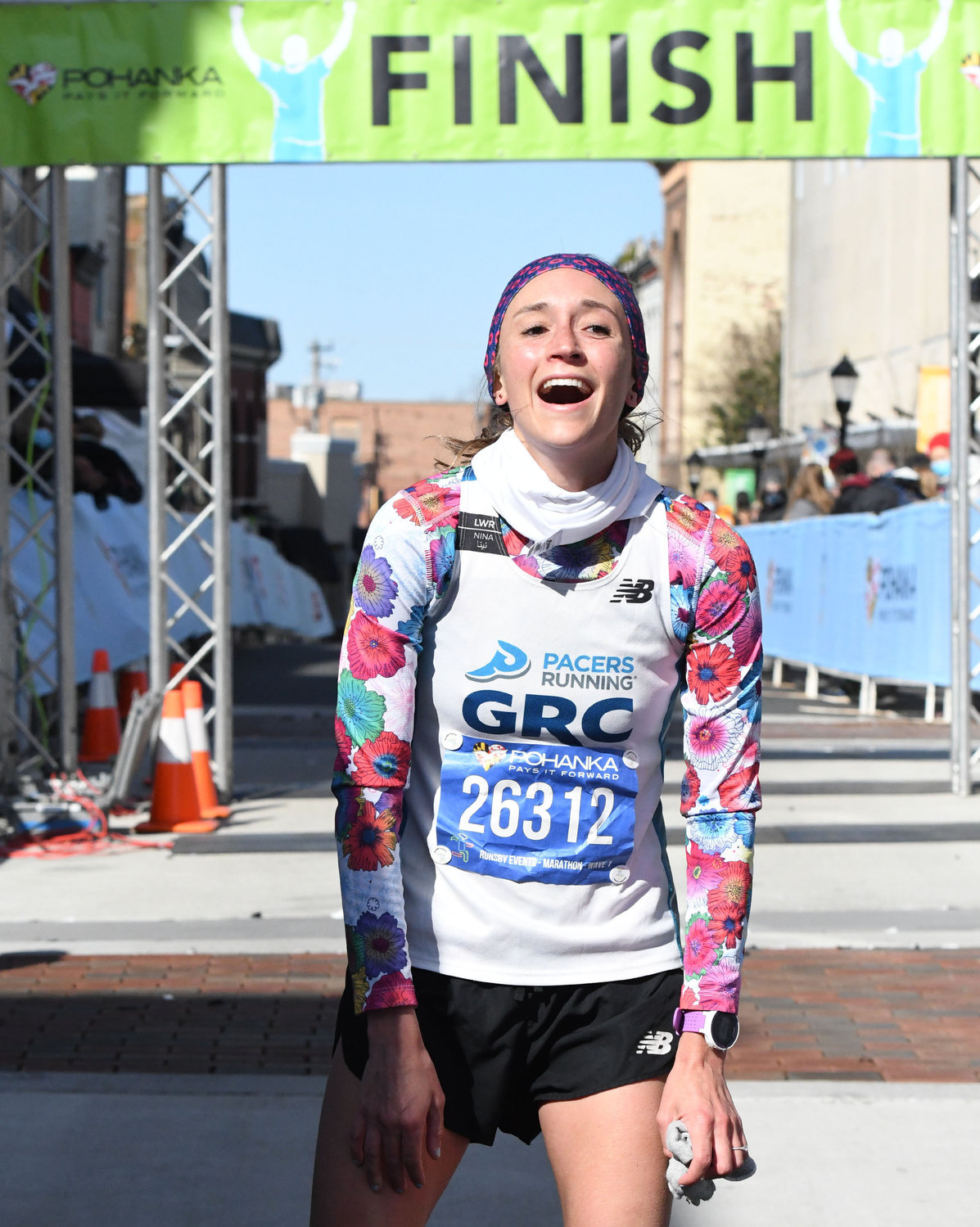 Natalie Patterson, 28, of Fredericksburg, Va., reacts at she crosses the finish line as the Female winner of the 2021 Salisbury Marathon.