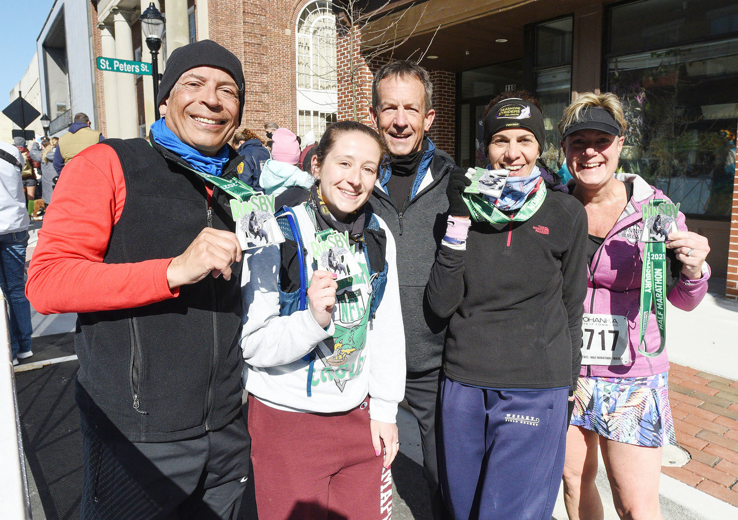 A running group from Rehoboth Beach celebrates together after competing in the 2021 Salisbury Marathon, Half-Marathon and #RunSBY 5k.