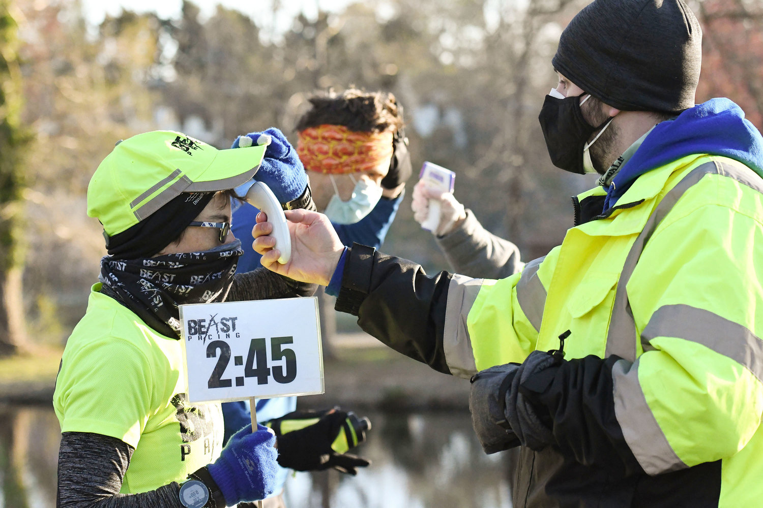 Ben Pittsley, right, does temperature checks on runners.