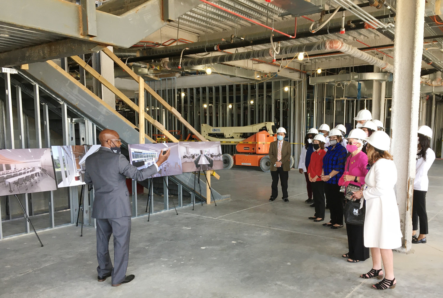 Using architect renderings on posters, Dr. Rondall E. Allen explains to a group of dignataries how the new UMES School of Pharmacy & Health Professions will appear when completed in 2022.