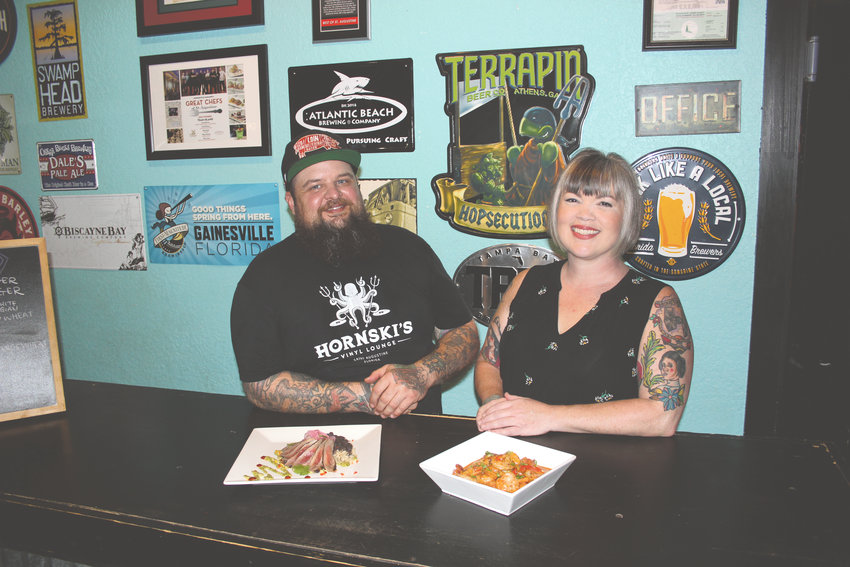 Ben and Lindy Loose show off their flank steak and shrimp and grits.