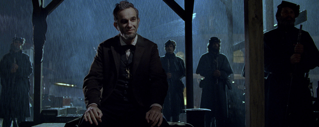 "Abraham Lincoln (Daniel Day-Lewis) brings in men to buy votes to pass the 13th amendment abolishing slavery in ""Lincoln."""